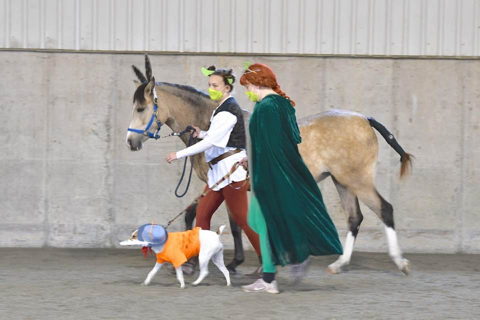 Celebrate Halloween With Your Horse - two girls in costumes dog - Equine Simplified